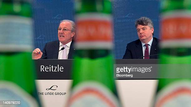 Wolfgang Reitzle chief executive officer of Linde AG left speaks as Georg Denoke chief financial officer of Linde AG listens during the company's...