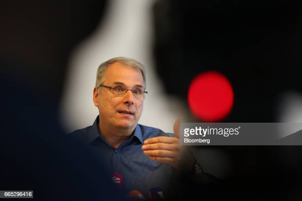 Wolfgang SchaeferKlug chairman of the work council at Adam Opel AG gestures as he speaks during a news conference in Ruesselheim Germany on Thursday...