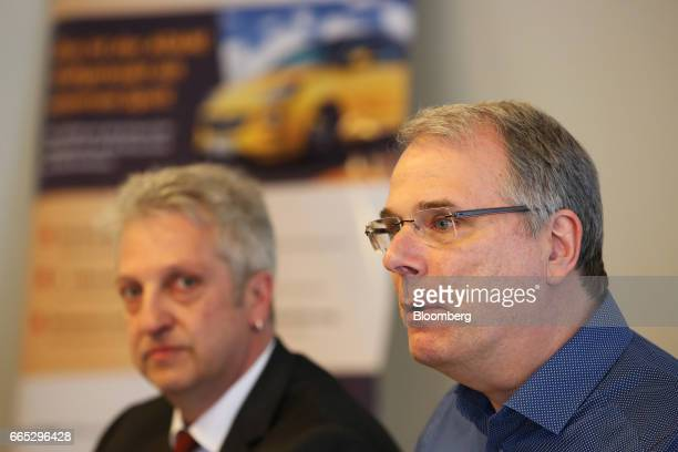 Wolfgang SchaeferKlug chairman of the work council at Adam Opel AG right speaks as Herrn Uwe Schuetz secretary of the IG Metall labor union looks on...