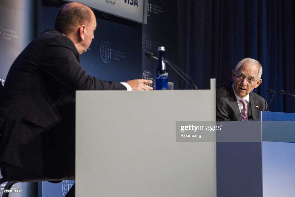 Wolfgang Schaeuble, German's Finance Minister, right, speaks during the Institute of International Finance (IIF) annual membership meeting in Washington, D.C., U.S., on Thursday, Oct. 12, 2017. Schaeuble said the new government will stay on its existing course and will be pro-European. Photographer: Zach Gibson/Bloomberg via Getty Images
