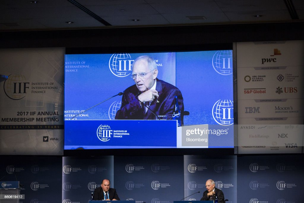 Wolfgang Schaeuble, German's Finance Minister, right, speaks while Axel Weber, chairman of the UBS Group AG, listens during the Institute of International Finance (IIF) annual membership meeting in Washington, D.C., U.S., on Thursday, Oct. 12, 2017. Schaeuble said the new government will stay on its existing course and will be pro-European. Photographer: Zach Gibson/Bloomberg via Getty Images