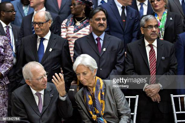 Wolfgang Schaeuble Germany's finance minister bottom left talks to Christine Lagarde managing director of the International Monetary Fund during an...