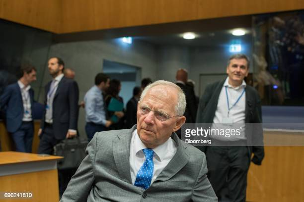 Wolfgang Schaeuble Germany's finance minister center arrives ahead of Euclid Tsakalotos Greece's finance minister left for a Eurogroup meeting of...