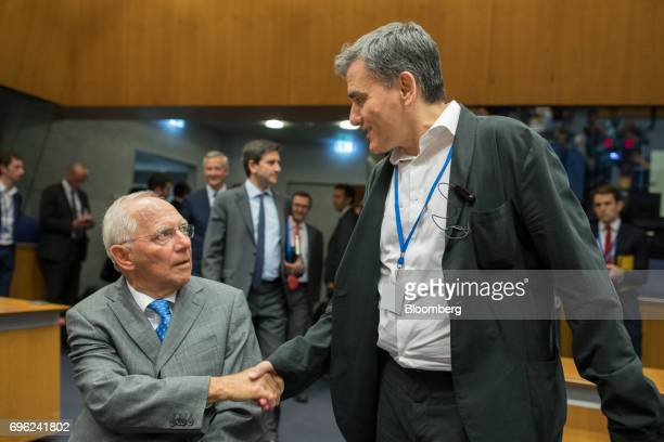Wolfgang Schaeuble Germany's finance minister left greets Euclid Tsakalotos Greece's finance minister ahead of a Eurogroup meeting of European...