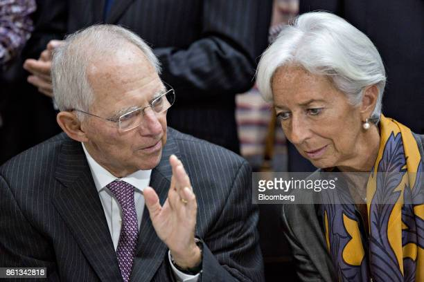 Wolfgang Schaeuble Germany's finance minister left speaks with Christine Lagarde managing director of the International Monetary Fund during an...