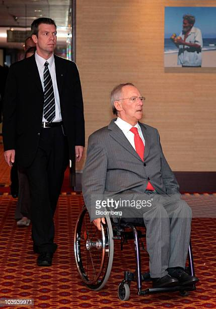 Wolfgang Schaeuble Germany's finance minister right leaves a session at the Banks in Crisis conference in Frankfurt Germany on Thursday Sept 9 2010...