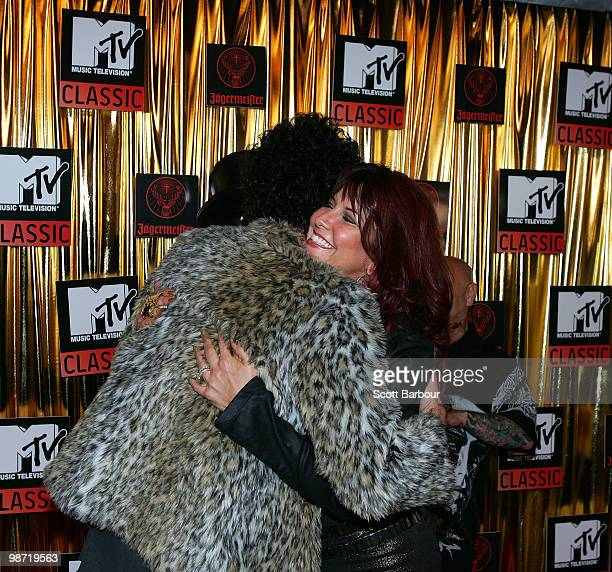 Wolfmother's Andrew Stockdale hugs Slash's wife Perla Ferrar at the 'MTV Classic The Launch' music event at the Palace Theatre on April 28 2010 in...