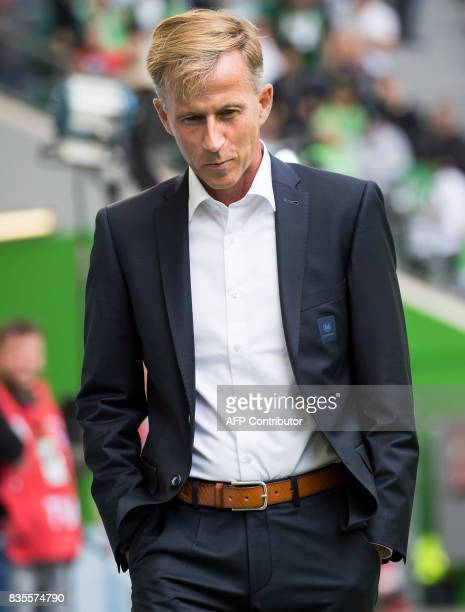 Wolfsburg Dutch head coach Andries Jonker watch proceedings during the German first division Bundesliga football match Wolfsburg v Dortmund at the...