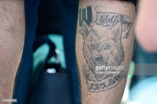 A Wolfsburg fan with a tattoo attends the celebrations in Wolfsburg northern Germany on May 31 2015 after winning the German Cup DFB Pokal final...