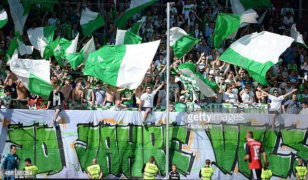 Wolfsburg fans are pictured during the Bundesliga match between FC Ingolstadt and VfL Wolfsburg at Audi Sportpark on September 12 2015 in Ingolstadt...