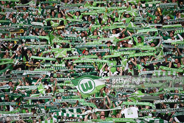 Wolfsburg fans enjoy the atmosphere ahead of the DFB Cup Final match between Borussia Dortmund and VfL Wolfsburg at Olympiastadion on May 30 2015 in...