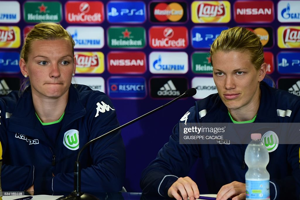 VFL Wolfsburg forward Alexandra Popp from Germany (L) and Lara Dickenmann of Switzerland attend a press conference on the eve of the UEFA Women's Champions League Final match against OL Lyon on May 25, 2016 at the Stadio Citta del Tricolore in Reggio Emilia. / AFP / GIUSEPPE