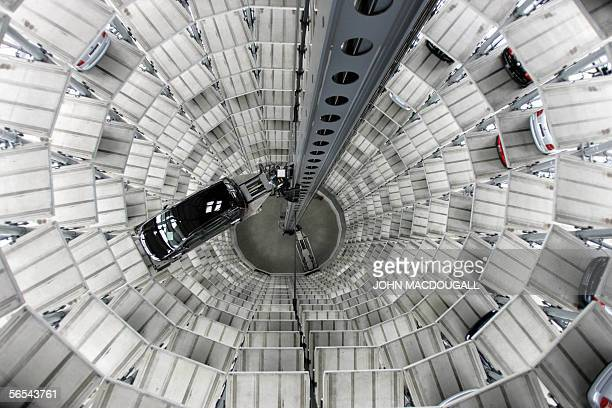FILES View taken 07 March 2005 showing a robot lift carrying a car in a storage silo near Volkswagen's Wolfsburg manufacturing center Volkswagen AG...