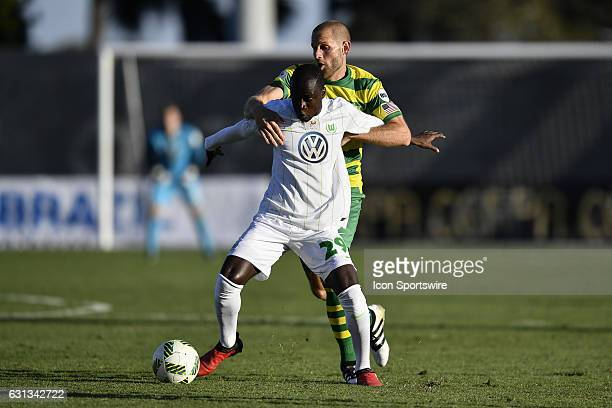 Wolfsburg midfielder Amara Conde holds off Tampa Bay Rowdies midfielder Keith Savage during the first half of a Florida Cup soccer game between the...