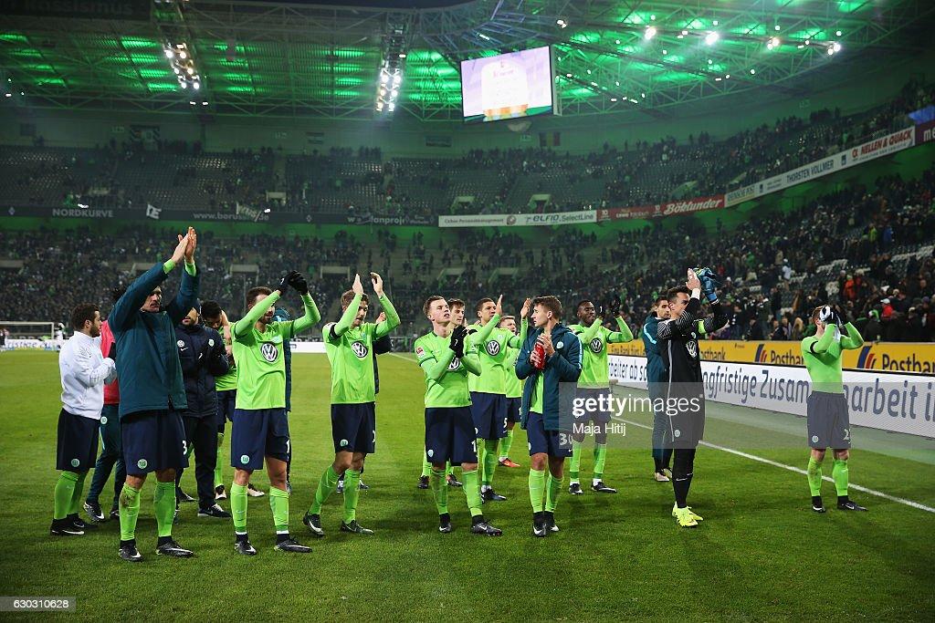 Wolfsburg players celebrate after the Bundesliga match between Borussia Moenchengladbach and VfL Wolfsburg at Borussia-Park on December 20, 2016 in Moenchengladbach, Germany.