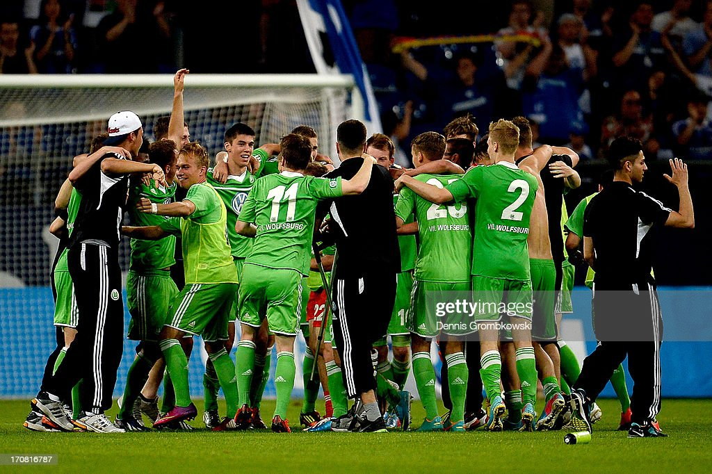 Wolfsburg players celebrate after winning the A Juniors Championships semifinal second leg match between Schalke 04 and VfL Wolfsburg at Veltins-Arena on June 18, 2013 in Gelsenkirchen, Germany.