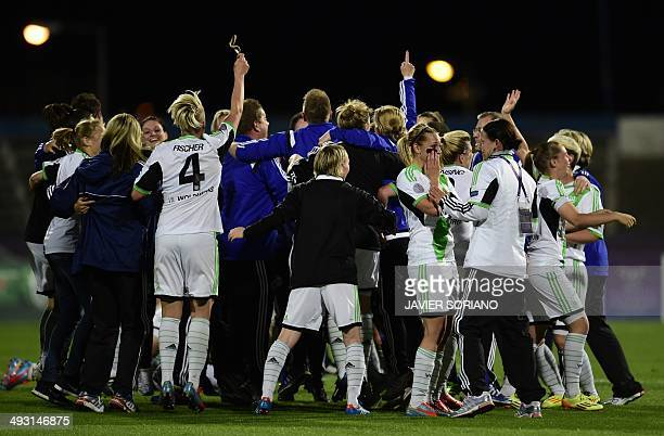 Wolfsburg players celebrate after winning the UEFA Women's Champions League final football match Tyreso FF vs Vfl Wolfsburg at Restelo stadium in...