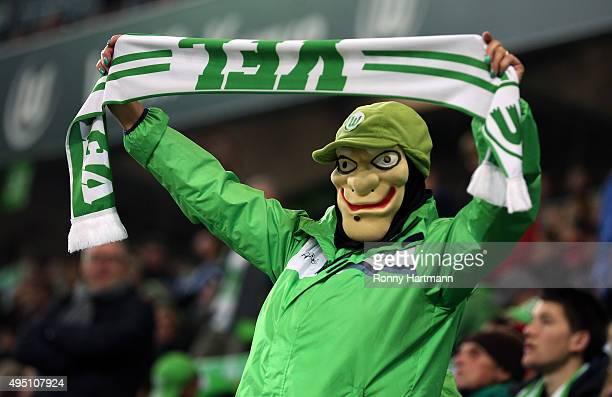 Wolfsburg supporter wearing a halloween mask cheers during the Bundesliga match between VfL Wolfsburg and Bayer Leverkusen at Volkswagen Arena on...