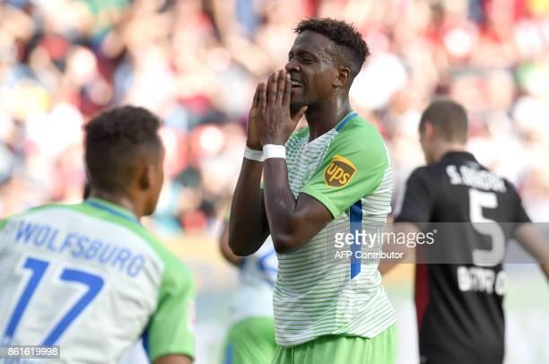 Wolfsburg's Belgian forward Divock Origi reacts during the German first division Bundesliga football match Bayer Leverkusen vs VfL Wolfsburg in...