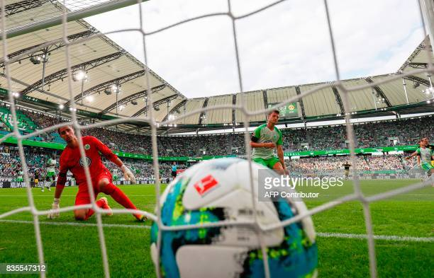 Wolfsburg's Belgian goalkeeper Koen Casteels and Wolfsburg defender Robin Knoche watch the ball in the back of the net after Dortmund's Gabonese...