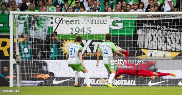 Wolfsburg's Belgian goalkeeper Koen Casteels fails to save a shot from Dortmund's US midfielder Christian Pulisic scoring the opening goal during the...