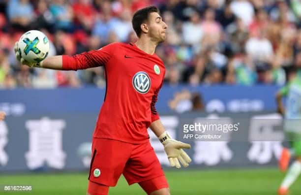 Wolfsburg's Belgian goalkeeper Koen Casteels plays the ball during the German First division Bundesliga football match Bayer Leverkusen vs VfL...