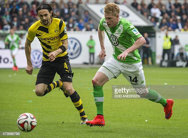 Wolfsburg's Belgian midfielder Kevin De Bruyne and Dortmund's Serbian defender Neven Subotic vie for the ball during the German first division...