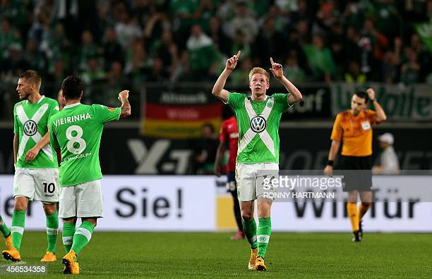 Wolfsburg's Belgian midfielder Kevin De Bruyne celebrates scoring his team's first goal during the UEFA Europa League group H football match between...