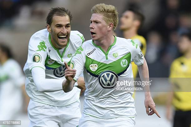 Wolfsburg's Belgian midfielder Kevin De Bruyne celebrates scoring with his teammates during the German Cup DFB Pokal final football match between BVB...