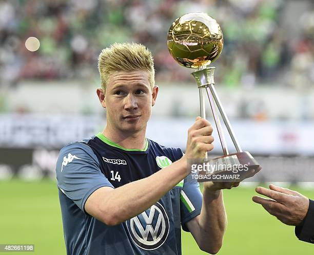 Wolfsburg's Belgian midfielder Kevin De Bruyne holds his trophy for 'Best Player of The year' awarded by German sports journalists ahead of the...