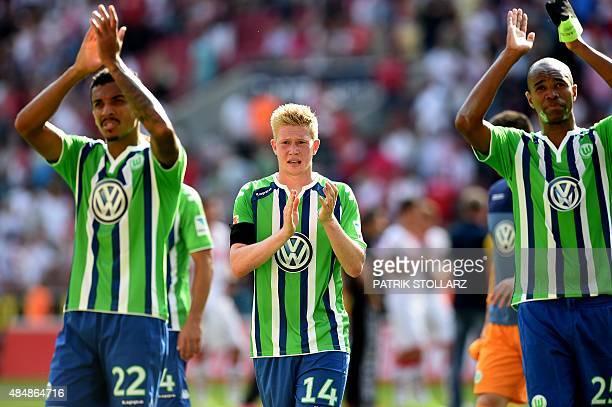 Wolfsburg's Belgian midfielder Kevin De Bruyne reacts next to Wolfsburg's Brazilian defender Naldo and Wolfsburg's Brazilian midfielder Luiz Gustavo...
