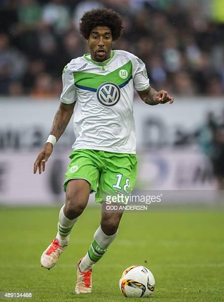 Wolfsburg's Brazilian defender Dante runs with the ball during the German first division Bundesliga football match VfL Wolfsburg vs Hertha BSC Berlin...
