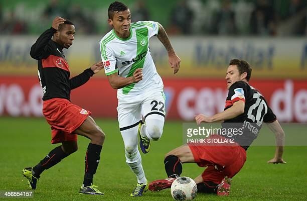 Wolfsburg's Brazilian defender Luiz Gustavo Stuttgart's Guinean midfielder Ibrahima Traore and Stuttgart's midfielder Christian Gentner vie for the...