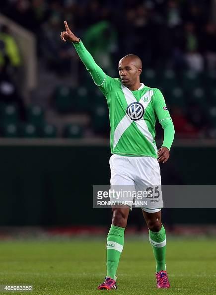 Wolfsburg's Brazilian defender Naldo celebrates after scoring his team's first goal during the UEFA Europa League firstleg Round of 16 football match...