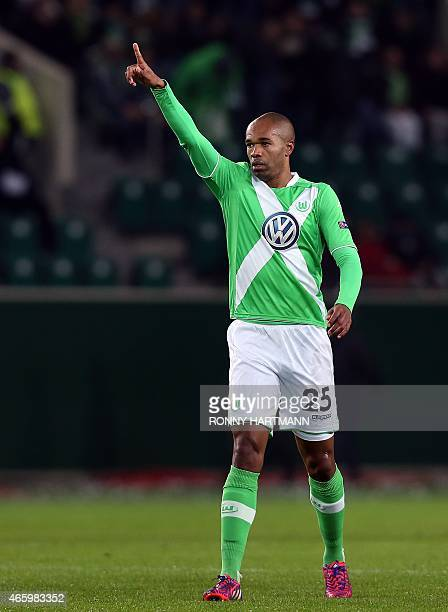 Wolfsburg's Brazilian defender Naldo celebrates after scoring his team's first goal during the UEFA Europa League firstleg Round of 16 football match...