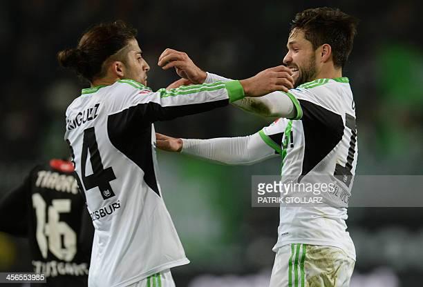 Wolfsburg's Brazilian midfielder Diego and Wolfsburg's Swiss defender Ricardo Rodriguez celebrate scoring 10 during the German first division...