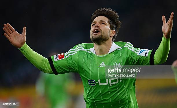Wolfsburg's Brazilian midfielder Diego celebrates scoring for 01 during the German first division Bundesliga football match Borussia Moenchengladbach...