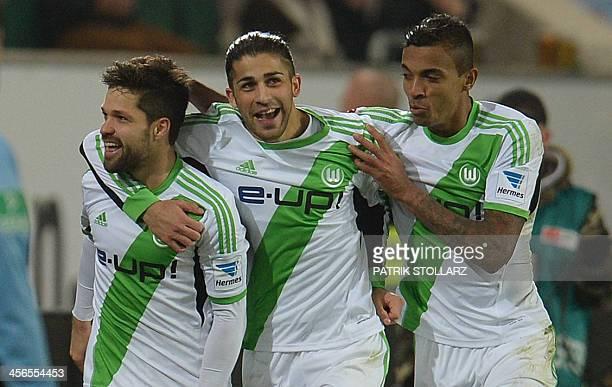 Wolfsburg's Brazilian midfielder DiegoWolfsburg's Brazilian defender Luiz Gustavo and Wolfsburg's Swiss defender Ricardo Rodriguez celebrate during...
