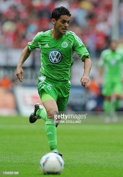 Wolfsburg's Brazilian midfielder Josue plays the ball during the German first division Bundesliga football match FC Koeln vs VfL Wolfsburg in the...