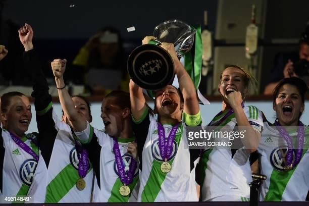Wolfsburg's captain and midfielder Nadine Kessler raises the trophy after winning the UEFA Women's Champions League final football match Tyreso FF vs...
