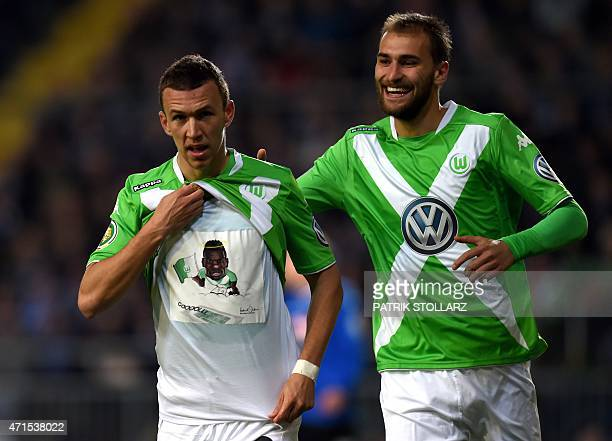 Wolfsburg's Croatian midfielder Ivan Perisic and Wolfsburg's Dutch striker Bas Dost celebrate during the German Cup DFB Pokal semifinal football...