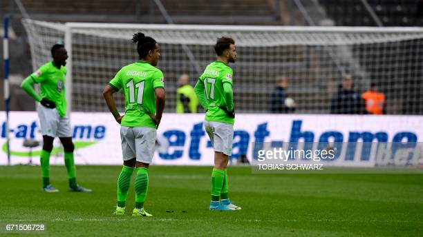 Wolfsburg's Daniel Didavi and his team mate Borja Mayoral react after the German First division Bundesliga football match between Hertha Berlin and...