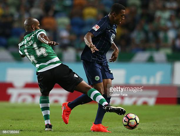 Wolfsburg's defender AntonLeander Donkor with Sporting CP's defender Naldo from Brazil in action during the Pre Season Friendly match between...