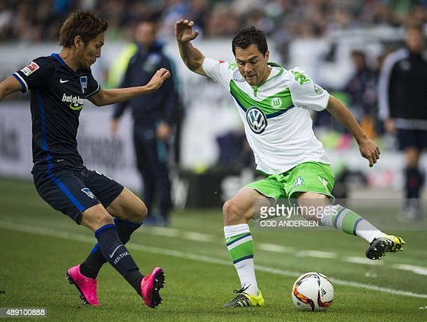 Wolfsburg's defender Marcel Schaefer and Hertha Berlin's Japanese forward Genki Haraguchi vie for the ball during the German first division...