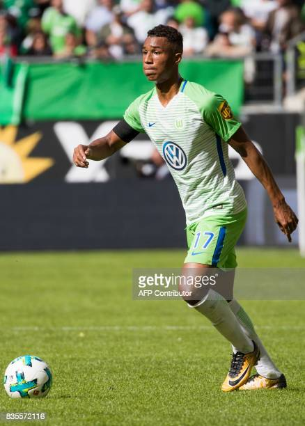 Wolfsburg's defender Ohis Felix Uduokhai runs with the ball during the German first division Bundesliga football match Wolfsburg v Dortmund at the...