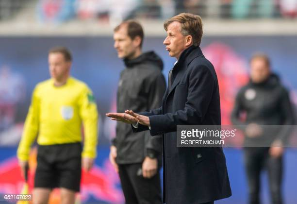 Wolfsburg's Dutch head coach Andries Jonker gestures during the German First division Bundesliga football match of RB Leipzig vs VfL Wolfsburg in...