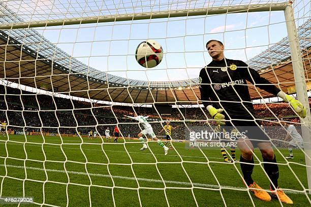 Wolfsburg's Dutch striker Bas Dost scores during the German Cup DFB Pokal final football match between BVB Borussia Dortmund and VfL Wolfsburg at the...