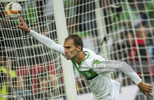 Wolfsburg's forward Bas Dost of the Netherlands celebrates scoring the opening goal during the German first division Bundesliga football match VfL...