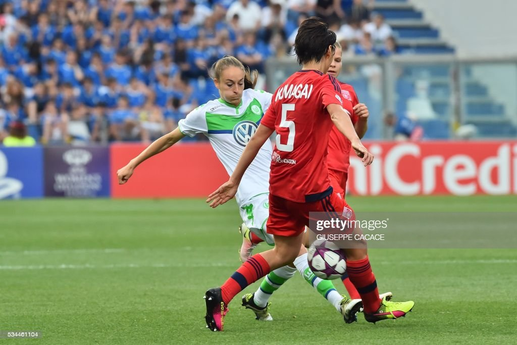 Wolfsburg's forward from Belgium Tessa Wullaert (L) fights for the ball with Olympique Lyonnais' defender from Japan Saki Kumagai during the UEFA Women's Champions League Final football match VFL Wolfsburg vs Lyon at the Citta del Tricolore stadium in Reggio Emilia on May 26, 2016. / AFP / GIUSEPPE