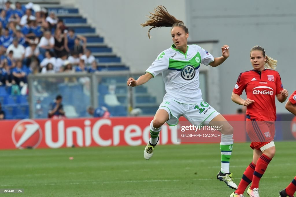 Wolfsburg's forward from Belgium Tessa Wullaert (L) jumps for the ball during the UEFA Women's Champions League Final football match VFL Wolfsburg vs Lyon at the Citta del Tricolore stadium in Reggio Emilia on May 26, 2016. / AFP / GIUSEPPE